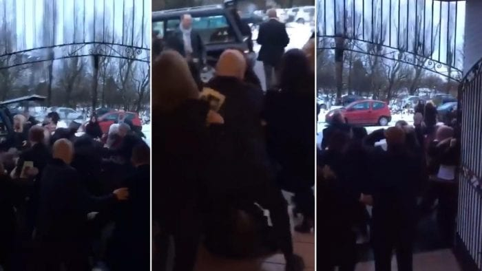 Punches fly as mass brawl breaks out between mourners at funeral, right next to the hearse