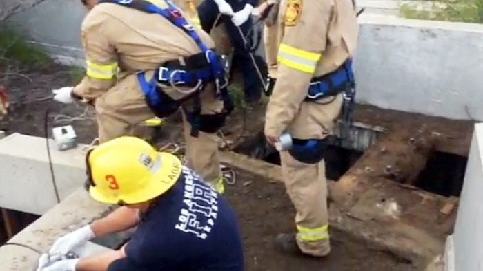 Teen Rescued After Falling into Drain Pipe