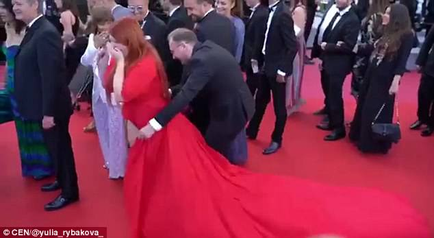 Plus-size model is left standing in her UNDERWEAR on Cannes red carpet after a passerby steps on her dress - but she's accused of 'faking it for fame'