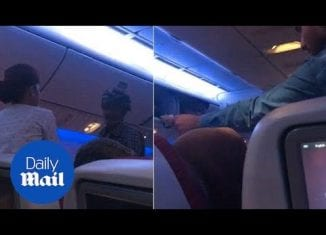 Moment man holds up commercial flight by begging passengers - Daily Mail