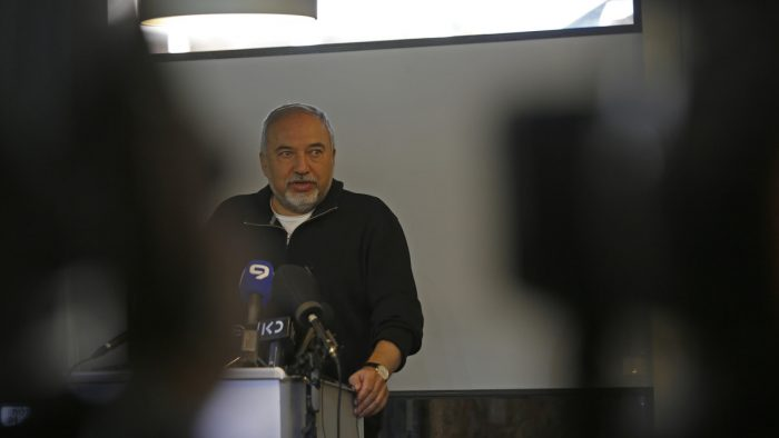 "Israeli Defence Minister Avigdor Lieberman speaks during the inauguration of an underground military operation centre in the Israeli settlement of Katzrin in the Golan Heights on April 10, 2018. Israeli Defence Minister Avigdor Lieberman said a soldier who shot a Palestinian along the Gaza border in a video that has been widely shared ""deserves a medal"". / AFP PHOTO / JALAA MAREY"