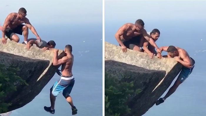 Daredevils Help Man Hanging From Rock