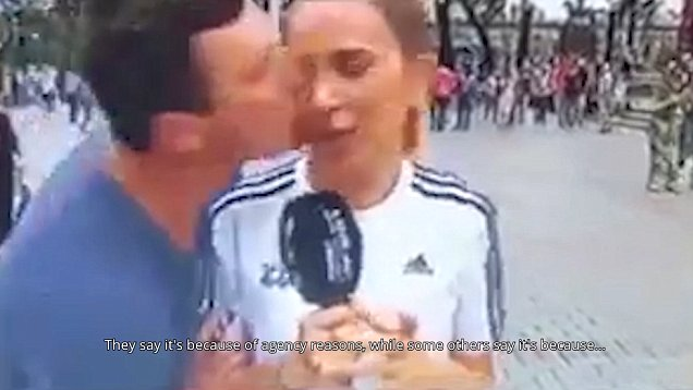 Spanish journalist is kissed by an aggressive fan during World Cup