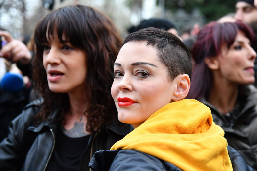 Italian actress Asia Argento (L) and US singer and actress Rose McGowan, who both accuse Harvey Weinstein of sexual assault, take part in a march organised by 'Non Una Di Meno' (Me too) movement on March 8, 2018 as part of the International Women's Day in Rome. (ALBERTO PIZZOLI/AFP/Getty Images)