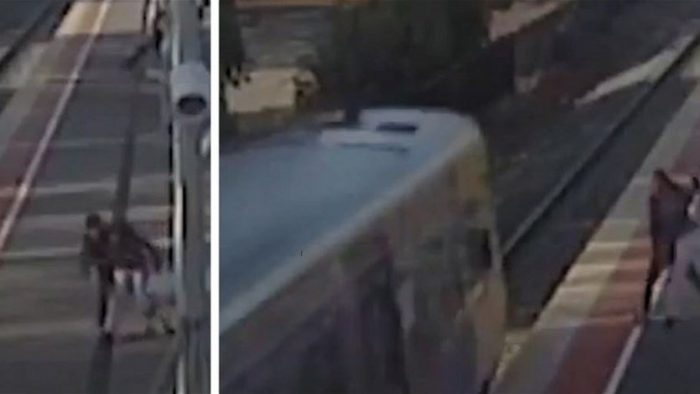 Man tries to throw 14-year-old girlfriend in front of oncoming train in horrifying CCTV