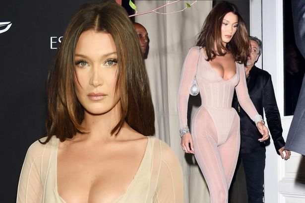Bella Hadid rocks a VERY daring low-cut nude unitard as she joins sister Gigi and Kendall Jenner at celeb-packed Harper's Bazaar ICONS party during NYFW