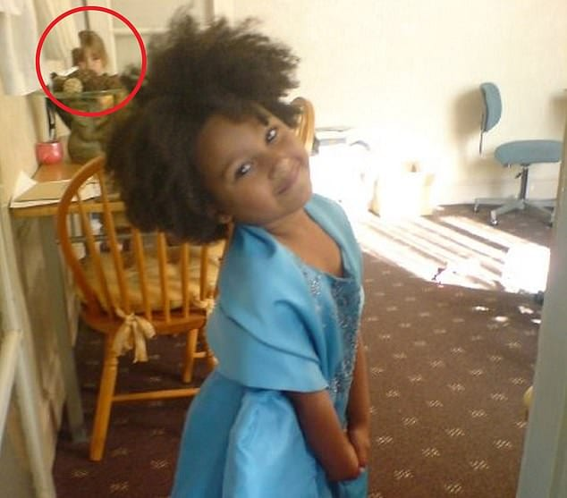 Mother believes ghostly image of girl caught on camera is 'future echo' of her daughter three years before she was born