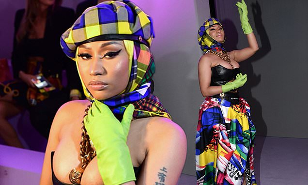 Nicki Minaj puts on a VERY busty display in plunging leather corset and bizarre green gloves as she wows on the FROW at Versace MFW show