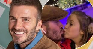 David Beckham shares kiss with daughter Harper as they enjoy ice skating trip