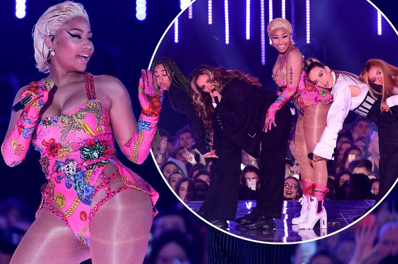 Perrie Edwards rests her head on Nicki Minaj's famous BUM during Little Mix's raunchy performance at the MTV EMAs