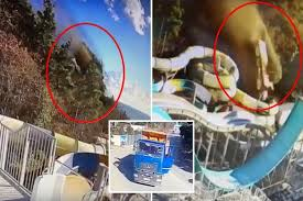 Terrifying moment out-of-control lorry with no driver plunges of cliff and comes crashing down on kids' water park