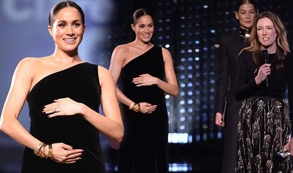Duchess of Sussex STUNS onlookers in surprise appearance to honour wedding dress designer at Fashion Awards