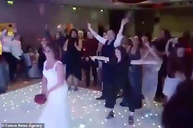 Playful brawl breaks out at wedding as guests tussle over bouquet