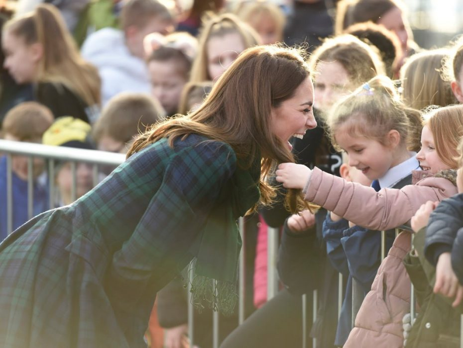 A schoolgirl touched Kate Middleton's hair and the duchess' reaction was perfect.