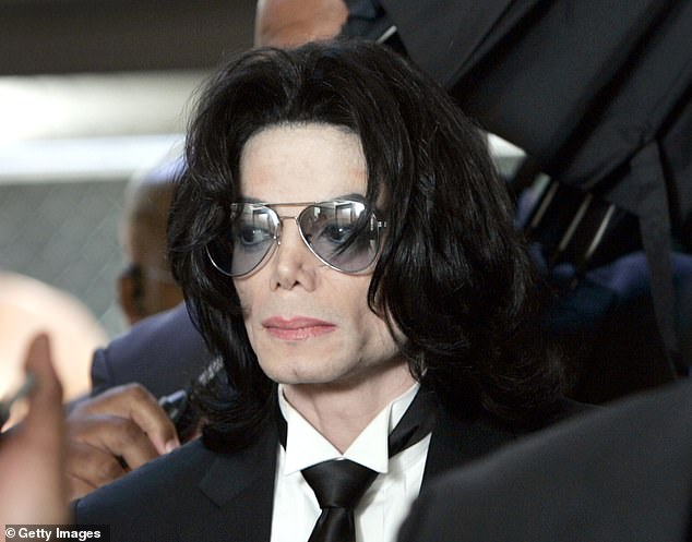 'They told me they would slice my neck': Michael Jackson's people 'threatened to kill his maid if she went public with sex abuse claims about the King of Pop'