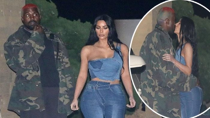 Kim Kardashian flaunts her incredible curves in skintight denim bottoms with a low-cut jean crop top as she shares a kiss with Kanye West at Nobu in Malibu