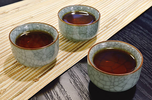 Three cups of black tea in China porcelain.