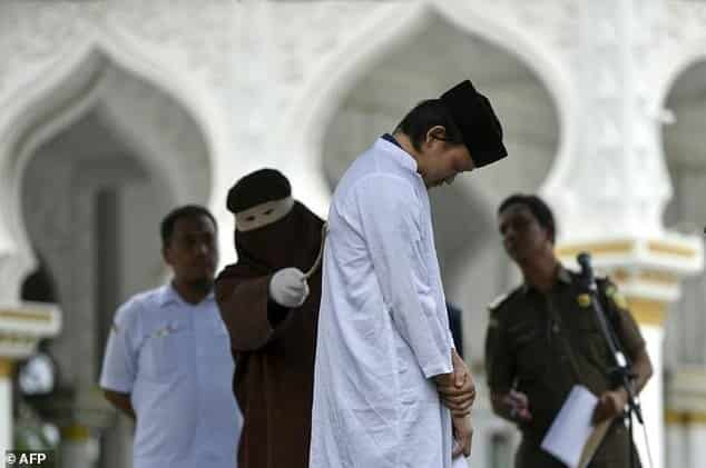 Indonesia's Aceh whips unmarried couples after hotel raid