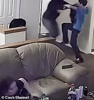 'Wrong house buster!' Shocking moment a homeowner fends off a shotgun-wielding thief who broke into the apartment looking for drugs, as his fiancée huddles in terror on the sofa