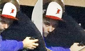 Justin Bieber hugs his bodyguard after getting back from solo spiritual retreat following the release of Selena Gomez's break-up track