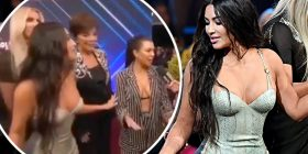 Kim Kardashian cuts off Kourtney during VERY awkward red carpet interview at People's Choice... as tension between sisters flares up again