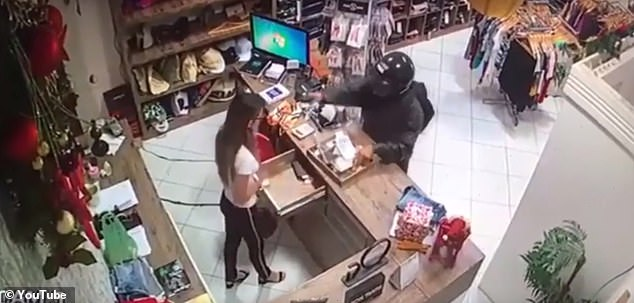 horrific moment woman is shot in the face by crazed gunman
